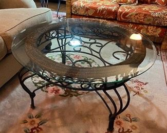 Glass top iron table.  Large and 2 matching smaller ones.
