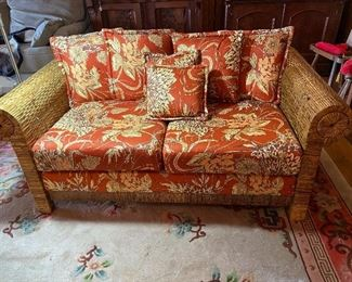Awesome sun room addition!  Rattan love seat with cushions.