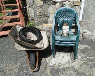 Chairs and wheelbarrow
