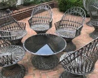 Spun Fiberglass Russell Woodard style outdoor dining. 2 tables and 9 chairs available. Table and 5 chairs $1500.00. A  table and 4 chairs is $1200.00