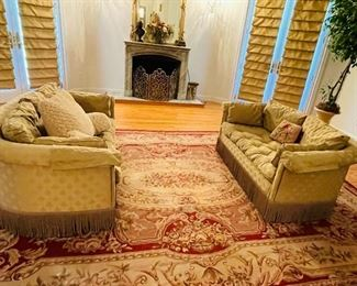 pair of Tomlinson settees, several needlepoint large rugs