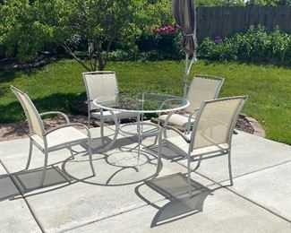 patio set; 4 chairs; glass top table