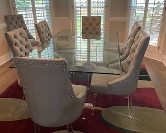 Beautiful glass top acrylic base and leather chairs.