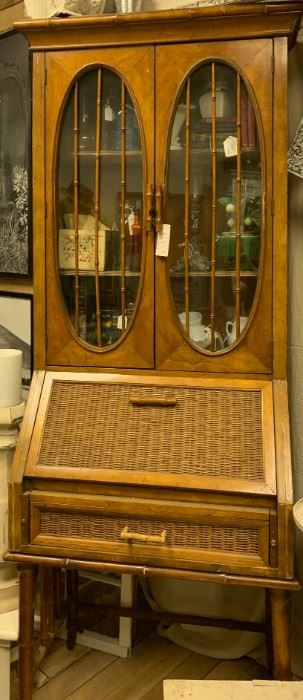 """Stunning vintage bamboo secretary. 1920s. Mid section opens to desk with compartments. All in excellent condition. Original glass doors. Is two pieces. Top sits on a platform. $200  Measures 18.5"""" deep, 28"""" wide and 80"""" tall. Two pieces."""