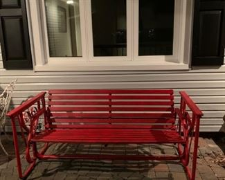 Excellent vintage glider, red, comfortable and in great shape. Wood and metal. Seats three average size adults. $275