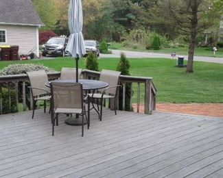 Patio set with umbrella and grill