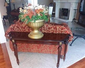 Sofa table and floral arrangement