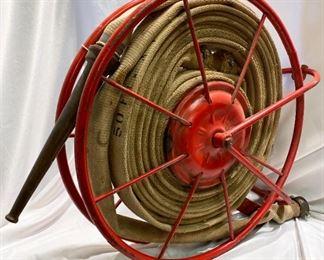 antique fire hose on reel