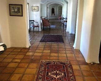 A hallway of rugs