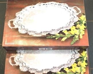 42 - 5 Silver plated serving trays