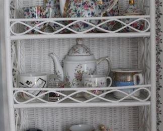 440 - Wicker shelf w/ assorted porcelains