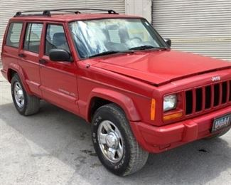 28 Image(s) VIN 1J4FT6853XL678304 Year: 1999 Make: Jeep Model: Cherokee Trim Level: Classic Engine Type: 4.0L Transmission: Automatic Miles: 186,302 Color: Red Driveline: 2WD Located In: Chattanooga,TN Operational Status: Runs and Drives *Engine Smokes - See Video* *Crack In The Windshield* *Rear Driver Tire Leaks Air* *Hood Latch Is Broken But Still Opens* Power Windows Power Locks Power Mirrors Manual Seats Cloth Interior *Sold On TN Title* **Sold as is Where is**  1-2