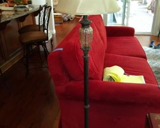 Floor lamp and red sofa.