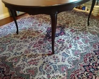 Beautiful dining table with leaves and protective pads. Rug in photo is not for sale.