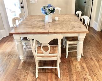 Very nice wood table with chairs large square size