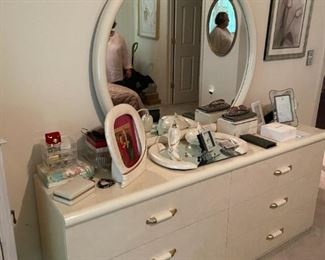 . . . a white lacquered mirrored dresser
