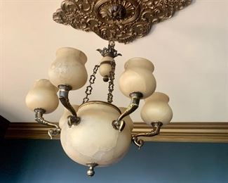this is a heavy stone (alabaster?) chandelier