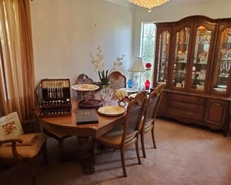 Formal dining set with 2 large leaves and custom pads.  Great lighted china cabinet.