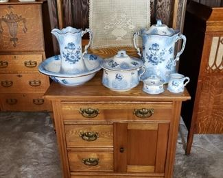 """Lovely Oak Wash Stand with 1 large / 2 smaller drawers plus door storage and beautiful brass hardware. Also a  large ANTIQUE QUEENSWEAR/ England  """"9"""" Piece Commode set ... VERY RARE!"""