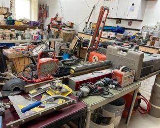 Workshop lights, grinders, vices, surveying tools