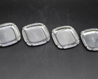 Four vintage sterling silver butter pats