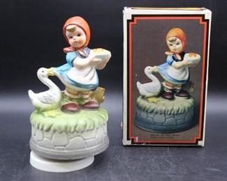 "Earthenware ""Musical Girl With Goose"" Musical Figurine"