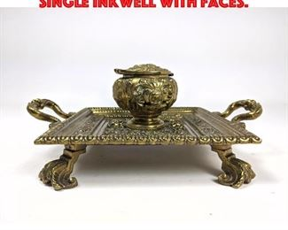 Lot 12 Fancy Brass Footed Inkwell. Single inkwell with faces.