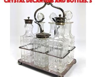 Lot 26 Silver Plate Tantalus. Crystal Decanters and bottles. S