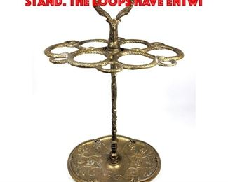 Lot 37 Vintage brass umbrella cane stand. The loops have entwi