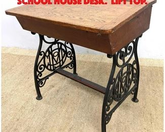 Lot 228 Antique Oak And Iron School House Desk. Lift top.