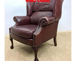 Lot 392 Leather Ball and Claw Wing Chair.