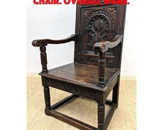 Lot 412 Heavily Carved Gothic Arm Chair. Overall wear.