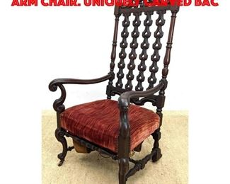 Lot 414 Antique Carved Tall Back Arm Chair. Uniquely carved bac