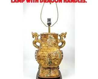 Lot 417 Asian Bronze Urn Table Lamp with Dragon Handles.