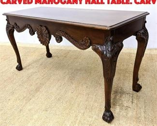 Lot 418 BAKER Furniture Richly carved Mahogany Hall Table. Carv