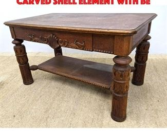 Lot 442 Antique Oak Library Table. Carved Shell Element with Be
