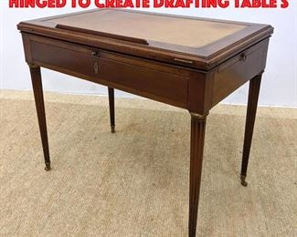 Lot 445 Leather Top Desk. Top hinged to create drafting table s