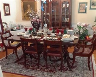 Dining room table with double pedestal base and leaves and six chairs