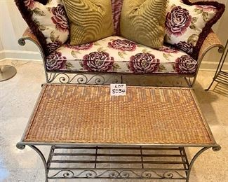 """Lot 8034. $850.00. Attractive 8 pc sunroom set in light colored wicker with metal frame and legs.  Very Cute.  The set includes: a Loveseat with rolled arms (57"""" L); a coffee table with wicker top (32"""" W);  2 arm chairs 32"""" W x 34"""" T); an Ottoman (25"""" W); a side table, flower stand and magazine rack (22"""" W) and 8 decorative accent pillows.  This really is a COMPLETE SET, sure to brighten any spot you put it."""