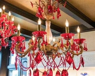 A colored Venetian style leaded glass 8 candle chandelier. H 36 x D 28.  $4,500.00