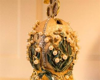 A reproduction Faberge Lilies of the Valley Egg from the original fashioned in 1898 as presented to Tsarina Alexandra. H 8 inches.  $500.00