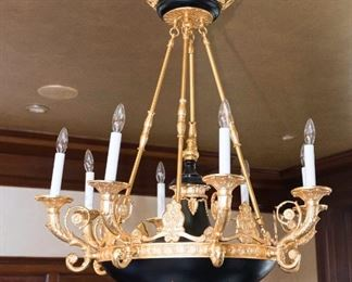 An Empire Style Gilt Metal Chandelier. Circa 2010-2013.   Dimensions: Height 46 x width 30 inches approximately.$5,000.00