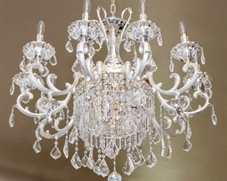 An American Silvered Leaded Glass Twelve Light Chandelier. Circa 2010-2013. No Marks Evident.  The chandelier in the Baccarat style having 12 electrified candles with silvered swag arms and multiple drops. Dimensions: Height 33 x width 31 inches approximately.    $3,500.00