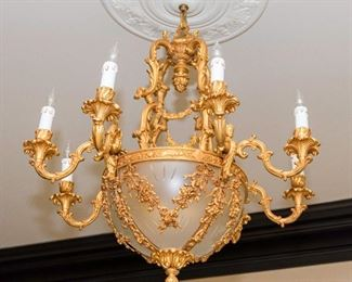 A Restauration Style Gilt Metal and Glass Eight Candle Chandelier.  Dimensions: Height 36 x width 32 inches approximately.$3,000.00