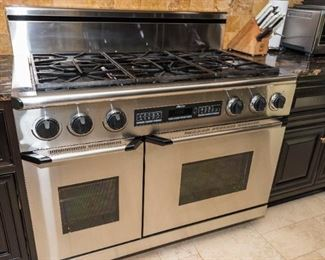 A Dacor Stainless Double Oven Six Burner Stove with Stainless Hood. Circa 2013-2014. No Serial Number Evident. Condition: Good to Very Good with moderate wear.$4,000.00