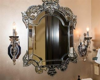 A Venetian Glass Mirror.  Circa 2000-2010.  Sconces Omitted. The mirror of Italian origin in the Venetian taste.  Condition : Very Good with no fractures or chips. Dimensions: Mirror Height 36 x width 24 ½ x depth 2 inches.   $250.00  Mirror: $100.00-$250.00