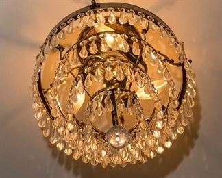 A Brass and Leaded Glass Diminutive Four Tier Chandelier. Circa 2010-2013. Condition: Very Good. Dimensions: Height 18 x width 14 inches approximately.    $250.00