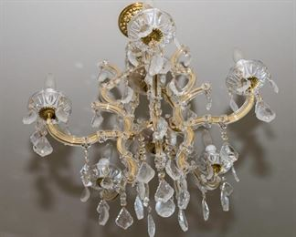 A Group of Six Venetian Style Leaded Glass and Brass Six Light Accented Chandeliers. Possibly Swarovski.  Circa 2010-2013. The group of 6 chandeliers in the Venetian style and likely manufactured by Swarovski each with clear glass scrolled arms around brass tubing having six electrified candles and with multiple leaded glass drops.  Condition of Group: Very Good. Dimensions: height 25 x width 30 approximately.For Six:   $4,800.00  Each $800.00