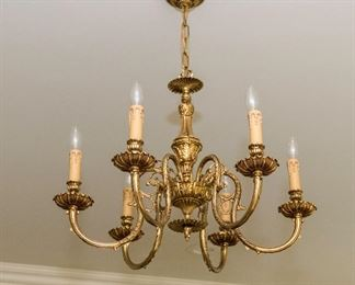 A Contemporary Brass Six Light Chandelier. Circa 2010-2013.  Condition: Very Good. Dimensions: Height 17 x width 24 inches.   $500.00