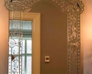 A Venetian Glass Mirror. Circa 2010-2013. Condition: Very Good. Dimensions: Height 48 x width 24 ½ x depth 1 inch.           $500.00